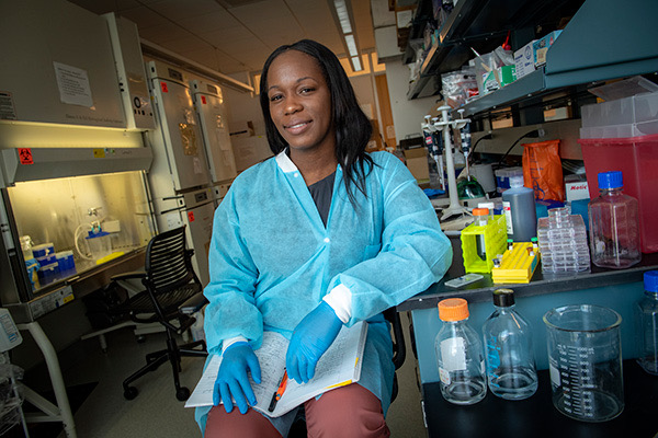Dr. Trivia Frazier of Obatala Sciences among her lab equipment, innovating Louisiana biotech.